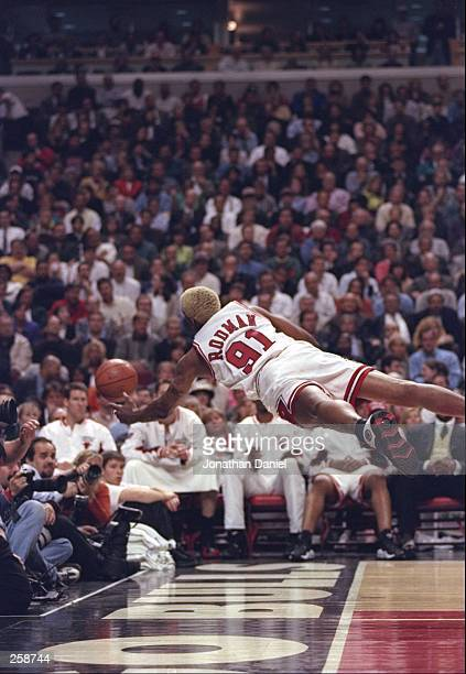 Forward Dennis Rodman of the Chicago Bull dives for the ball during a playoff game against the Atlanta Hawks at the United Center in Chicago,...