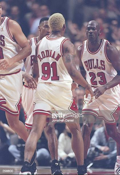 Guard Michael Jordan forward Dennis Rodman forward Scottie Pippen and center Brian Williams of the Chicago Bulls confer during a playoff game against...