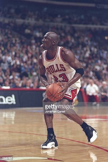 Guard Michael Jordan of the Chicago Bulls steps up to shoot the ball during a playoff game against the Atlanta Hawks at the United Center in Chicago...
