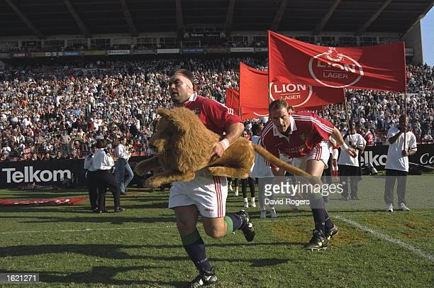 Jason Leonard leads the British Lions on to the field of play for the first match of the tour of South Africa against the Eastern Province in Port...