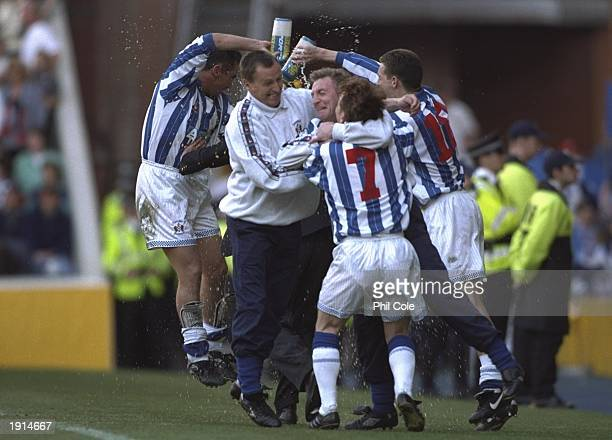Kilmarnock celebrate victory in the Tennents Scottish FA Cup Final after victory against Falkirk at Ibrox in Glasgow Scotland Kilmarnock won 10...