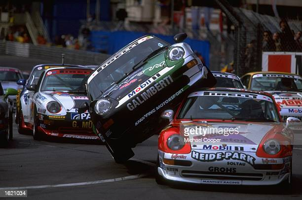 Matteo Maria Galimberti monts Harald Grohs on the first lap of the Porsche Super Cup on the Monte Carlo street circuit in Monaco Mandatory Credit...