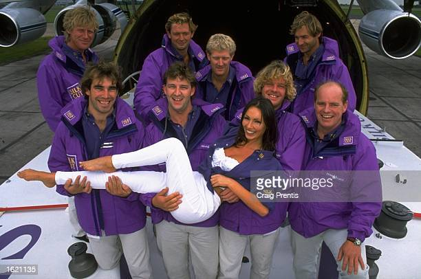 Model Kathy Lloyd with the crew of the Silk Cut W60 Shark as it arrives at Stansted Airport in England The yacht is Great Britain's entry for the...