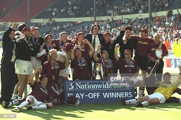 Northampton Town celebrate their victory against Swansea City in the Nationwide Division Three Play Off Final at Wembley Stadium in London, England....