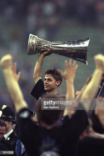 Olaf Thon of Schalke 04 lifts the UEFA Cup after the second leg of the final at the San Siro in Milan Italy The match was level after the two legs...