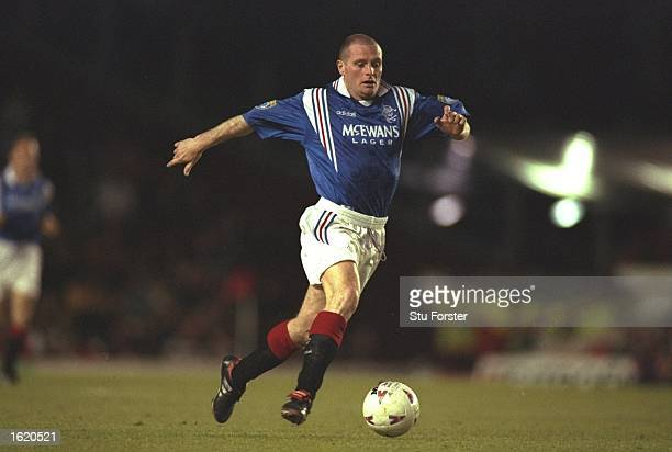 Paul Gascoigne of Glasgow Rangers in action playing against Arsenal for the Nigel Winterburn Testimonial match at Highbury in London England The game...