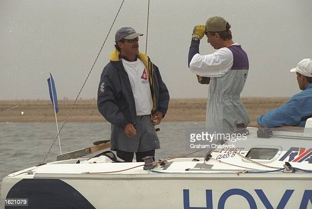 Peter Holmberg of the US Virgin Islands dicusses tactics during the Match Racing Championships of the Hoya Royal Lymington Cup in the Solent off the...