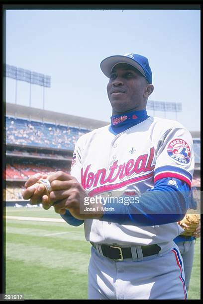Pitcher Carlos Perez of the Montreal Expos walks off the field during a game against the Los Angeles Dodgers at Dodger Stadium in Los Angeles...