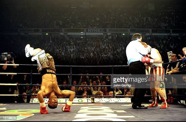 Prince Naseem Hamed of Great Britain somersaults with joy after retaining his WBO and IBF Featherweight titles against compatriot Billy Hardy at the...
