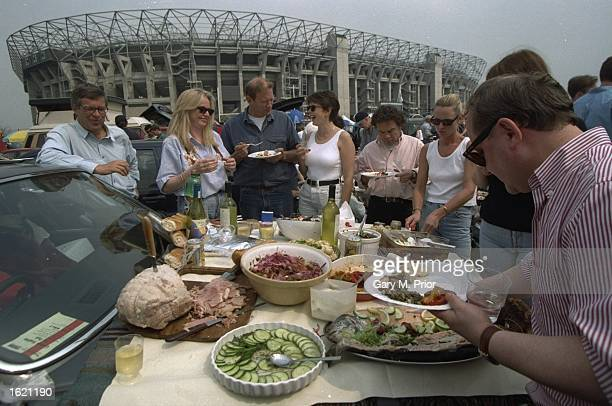 Spectators enjoy lunch in the Twickenham car park before the Middlesex Charity Sevens at Twickenham Rugby Ground in London, England. \ Mandatory...