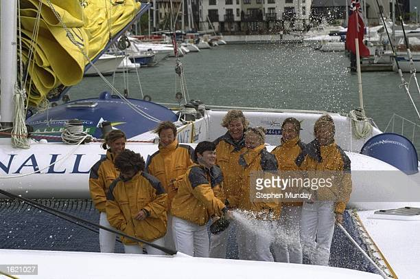 The crew open the champagne at the christening of the Royal Sun Alliance catamaran at Ocean Village in Southampton England Mandatory Credit Stephen...