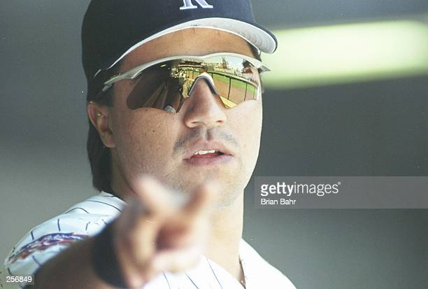 Third baseman Vinny Castilla of the Colorado Rockies points at the camera during a game against the Pittsburgh Pirates at Coors Field in Denver...