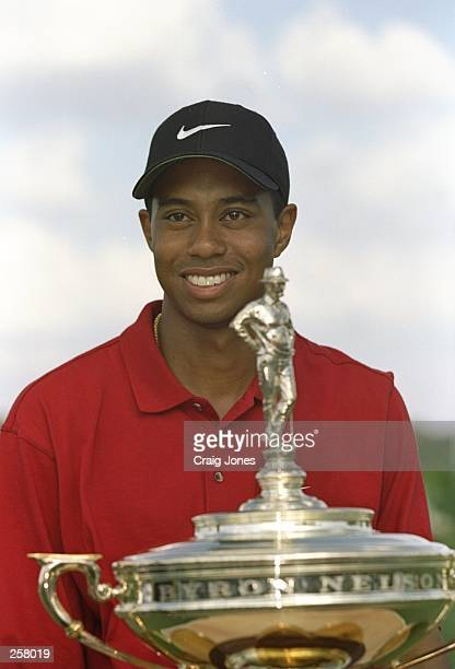 Tigers Woods holding the trophy for winning the GTE Byron Nelson Classic at the Four Seasons Resort & Club in Irving, Texas. Mandatory Credit: Craig...