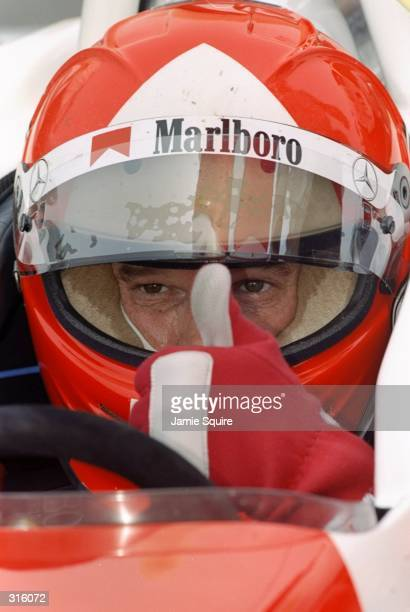Al Unser Jr of the USA gives a thumbsup sign from the cockpit of his Marlboro Team Penske Mercedes PC98 during the CART Motorola 300 at the Gateway...