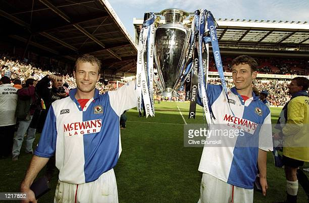 Alan Shearer and Chris Sutton of Blackburn Rovers celebrate with the Premiership trophy after winning the Premiership title during the FA Carling...