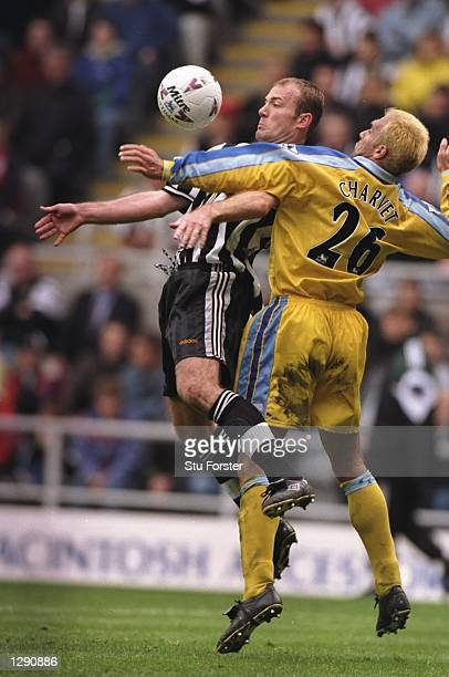 Alan Shearer of Newcastle United is tackled by Laurent Charvet of Chelsea during an FA Carling Premiership match at St James'' Park in Newcastle...