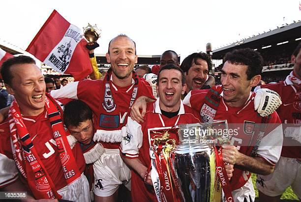 Arsenal players celebrate with the trophy after winning the championship in the FA Carling Premiership match against Everton at Highbury in London...