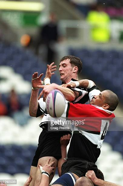 Charles Afuakwah of Glasgow Hawks tackles Simon Forsyth of Kelso during the Tennents Velvet Cup final at Murrayfield in Edinburgh, Scotland. Glasgow...