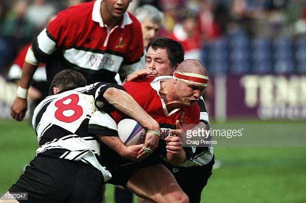 Chris Docherty of Glasgow Hawks is stopped during the Tennents Velvet Cup final against Kelso at Murrayfield in Edinburgh, Scotland. Glasgow Hawks...