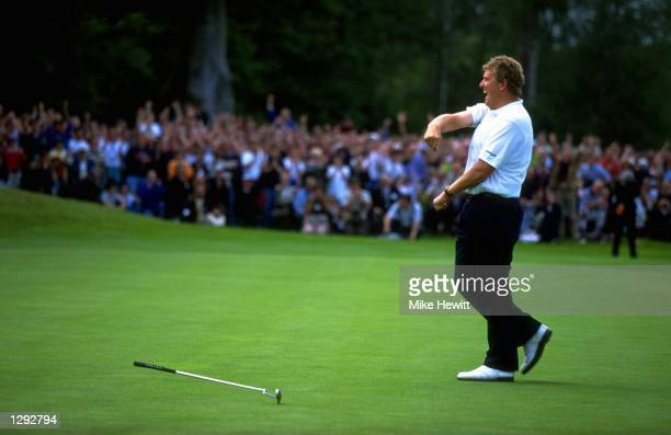 Colin Montgomerie of Scotland celebrates after holing a birdie putt on the 18th to win the Volvo PGA Championships at Wentworth Golf Club in Surrey,...