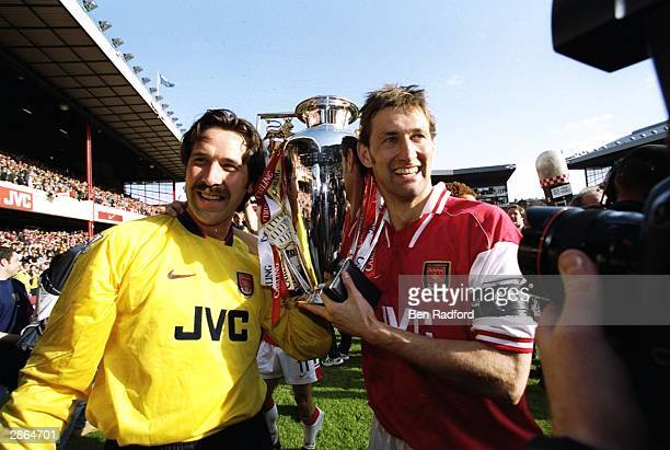 David Seaman of Arsenal and club captain Tony Adams hold the championship trophy after the FA Carling Premiership match against Everton at Highbury...