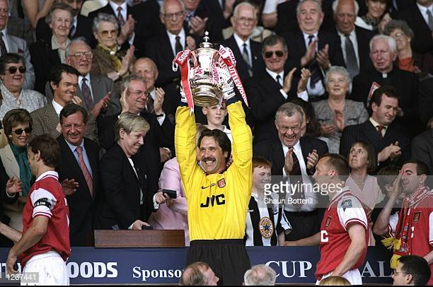 David Seaman of Arsenal lifts the FA Cup trophy after a 20 victory in the final against Newcastle United at Wembley in London Mandatory Credit Shaun...