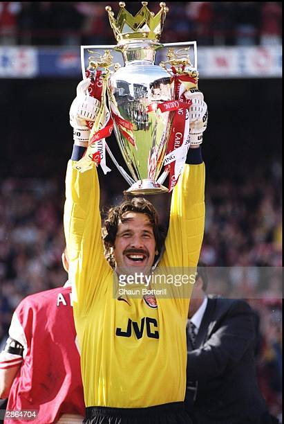 David Seaman of Arsenal proudly lifts the championship trophy after the FA Carling Premiership match against Everton at Highbury in London David...