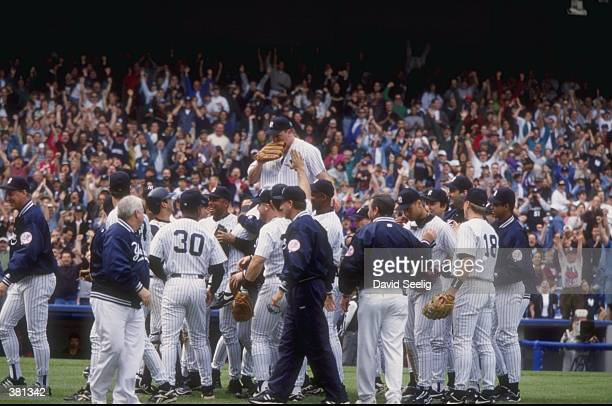 David Wells of the New York Yankees celebrates his perfect game against the Minnesota Twins with his teammates at Yankee Stadium in the Bronx, New...