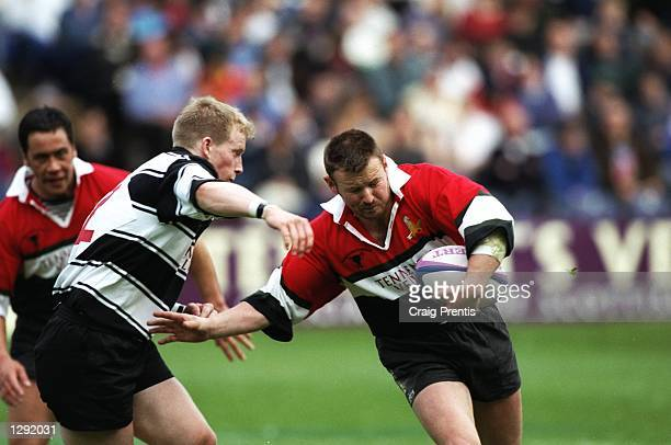 David Wilson of Glasgow Hawks goes past Iain Fairley of Kelso during the Tennents Velvet Cup final at Murrayfield in Edinburgh, Scotland. Glasgow...