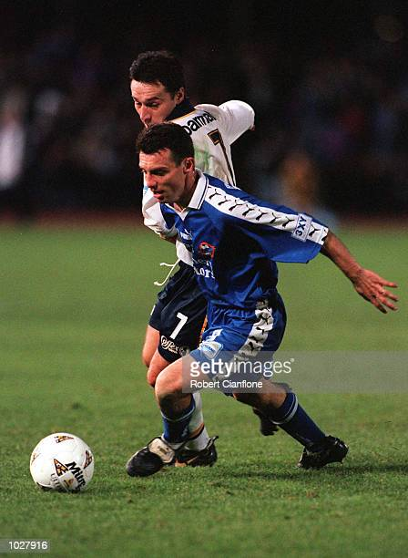 Fausto De Amicis of South Melbourne gets the ball away from Kresimir Marusic of Carlton during the NSL Grand Final between Carlton and South...