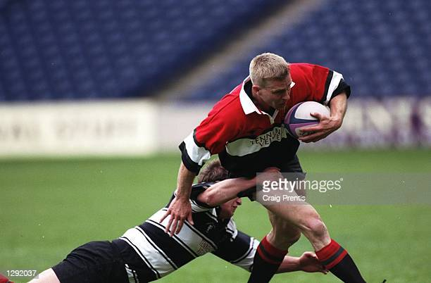 Glenn Metcalfe of Glasgow Hawks is tackled during the Tennents Velvet Cup final against Kelso at Murrayfield in Edinburgh, Scotland. Glasgow Hawks...