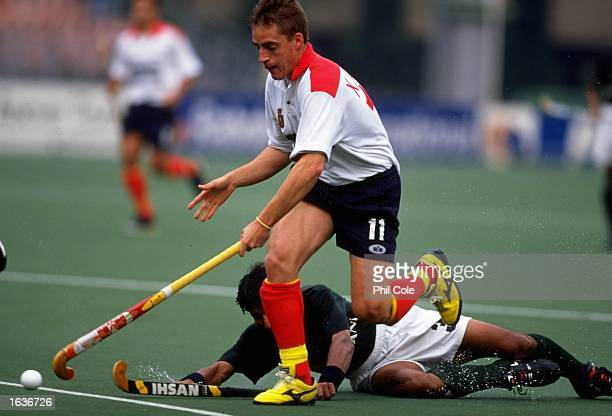Javier Arnau of Spain and Imran Tariq of Pakistan in action during the World Hockey Championship match in Utrecht Holland Spain won the match 21...