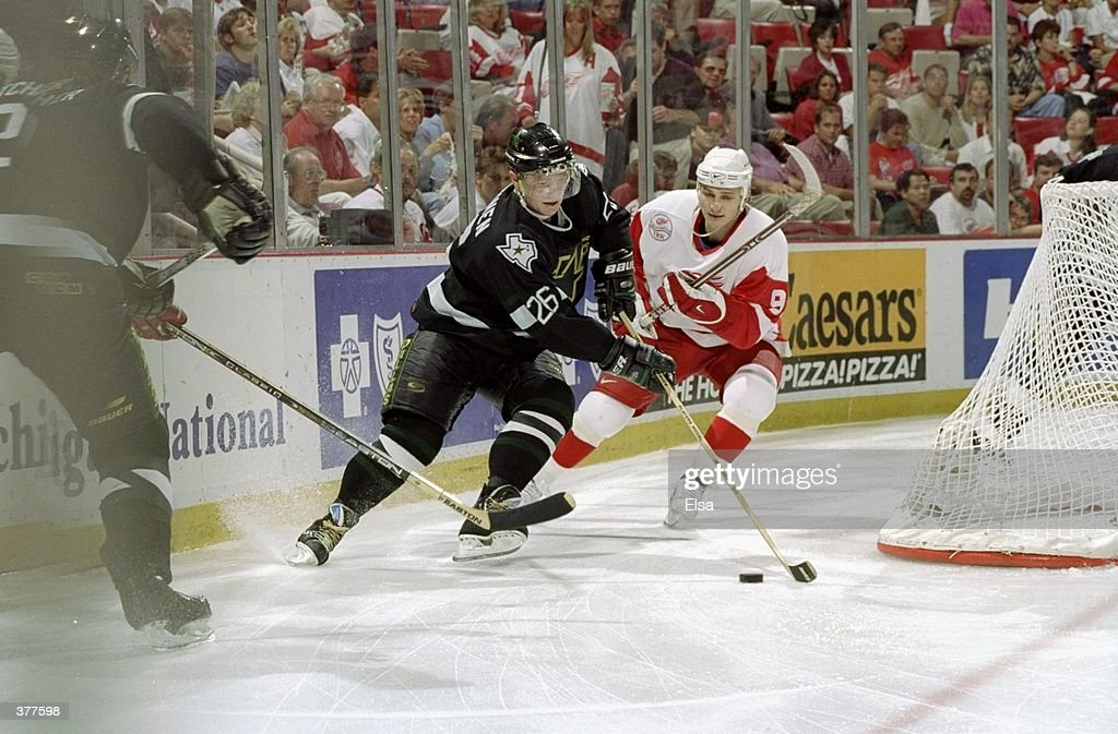 0942e5ff4 Jere Lehtinen of the Dallas Stars is pursued by Sergei Fedorov of ...