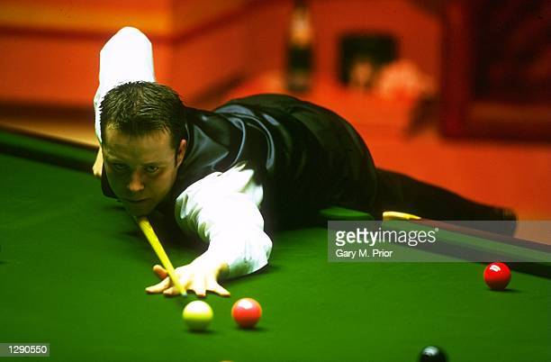 John Higgins of Scotland in action during the World Snooker Championship final against Ken Doherty of the Republic of Ireland at the Crucible Theatre...