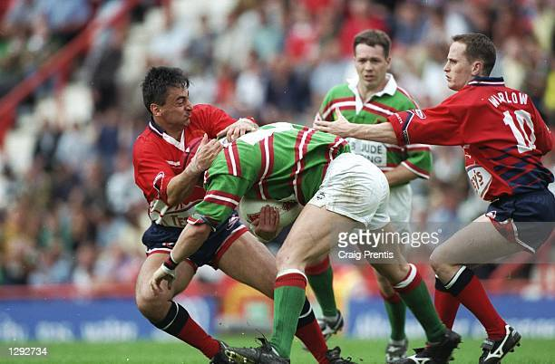 Kingsley Jones of Ebbw Vale tackles Nigel Davies of Llanelli during the Swalec Cup final at the Memorial Ground in Bristol England Llanelli won the...