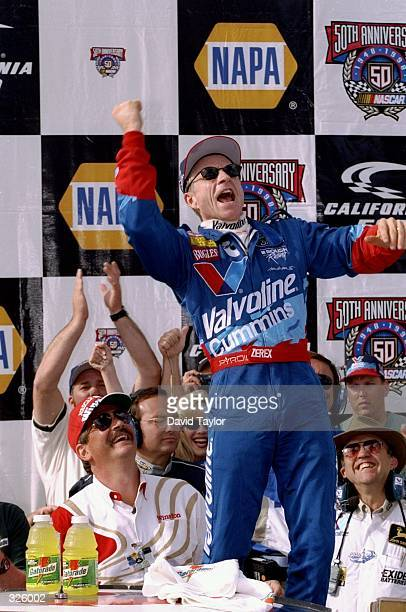 Mark Martin celebrates after winning the California 500 at California Speedway in Fontana California