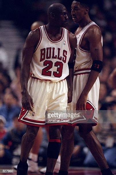 Michael Jordan bumps Scottie Pippen of the Chicago Bulls during the NBA Playoffs round 1 game against the Charlotte Hornets at the United Center in...