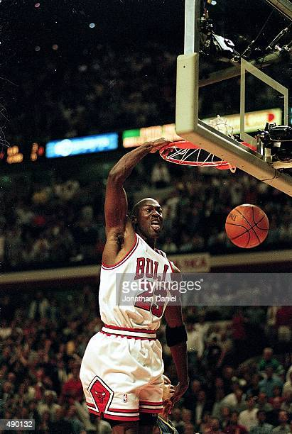 Michael Jordan of the Chicago Bulls dunks the ball during a Eastern Conference Finals game against the Indiana Pacers at the United Center in Chicago...