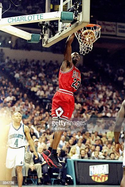 Michael Jordan of the Chicago Bulls jumps slam dunk during the Eastern Conference Semifinals against the Charlotte Hornets at Charlotte Coliseum in...