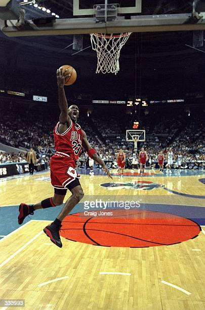 Michael Jordan of the Chicago Bulls jumps to make a layup during the East Conference Semifinals against the Charlotte Hornets at Charlotte Coliseum...