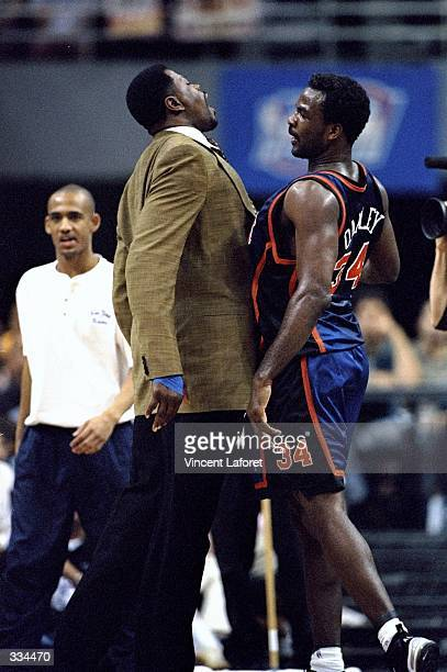 Patrick Ewing and Charles Oakley of the New York Knicks celebrate by bumping chests during game five of the first round of the Eastern Conference...