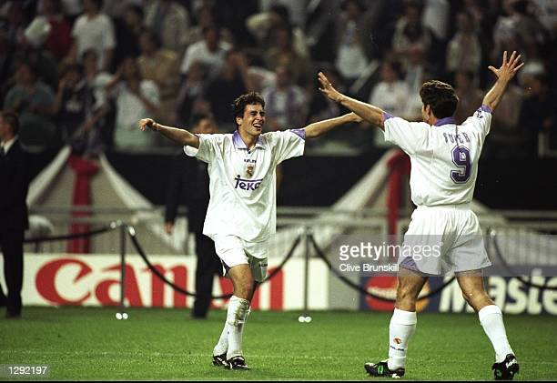 Raul and Davor Suker of Real Madrid celebrate after the Champions League final against Juventus at the Amsterdam Arena in Holland Real Madrid won the...