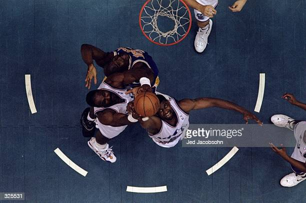 Shaquille O''Neal of the Los Angeles Lakers battles Karl Malone and Bryon Russell of the Utah Jazz for the rebound during the Lakers 99-95 NBA...