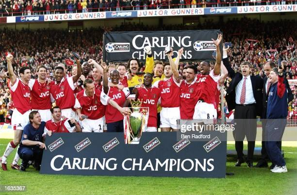 The Arsenal team celebrate with the trophy after winning the championship in the FA Carling Premiership match against Everton at Highbury in London...