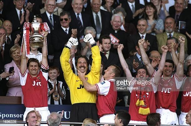 Tony Adams of Arsenal holds the trophy aloft after the FA Cup final against Newcastle United at Wembley Stadium in London Arsenal won the match 20...