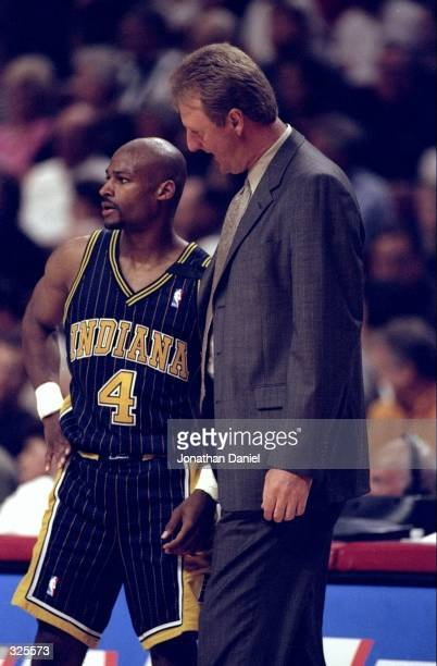 Travis Best talks with head coach Larry Bird of the Indiana Pacers guards Michael Jordan of the Chicago Bulls during the Bulls 8579 NBA Playoff win...