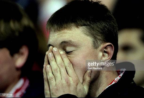 A dejected Arsenal fan during the FA Carling Premiership match against Leeds United played at Elland Road in Leeds England The match finished in a 10...