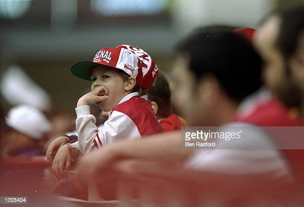 A dejected young Arsenal fan during the FA Carling Premiership match against Aston Villa played at Highbury in London England The match finished in a...