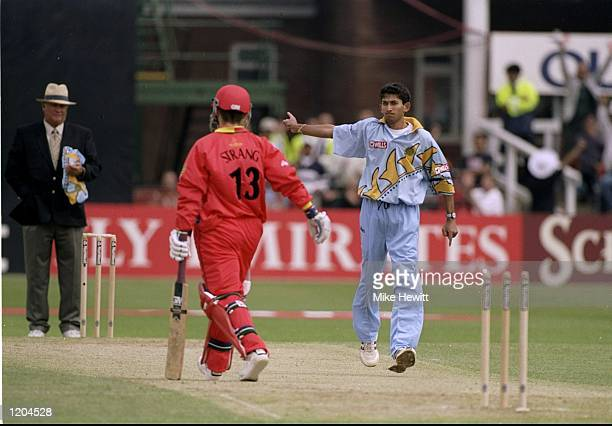 Ajit Agarkar of India points Paul Strang of Zimbabwe back to the pavillion during the Cricket World Cup Group A match played in Leicester England...