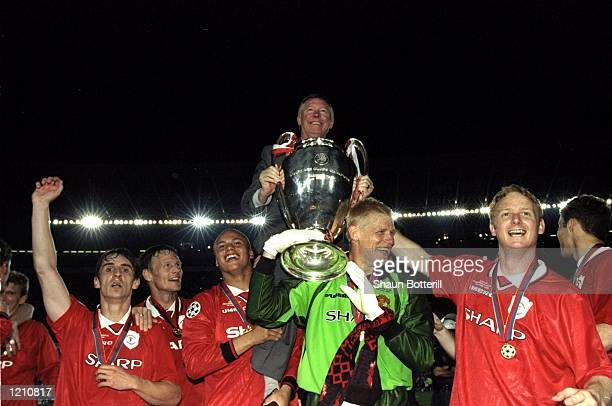 Alex Ferguson celebrates with Manchester United players and the European Cup after winning the European Champions League Final against Bayern Munich...